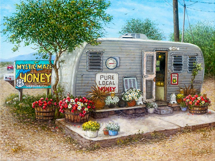 A small well-worn travel trailer sits alongside Route 66 in Needles, California, next to a sign offering Mystic Maze Honey for sale. Baskets, barrels and pots hold brightly colored flowers in front of the trailer and its open door. A thermometer hanging on the trailer shows a hot, 100 degree day, while a large sign advertises Pure Local Honey.