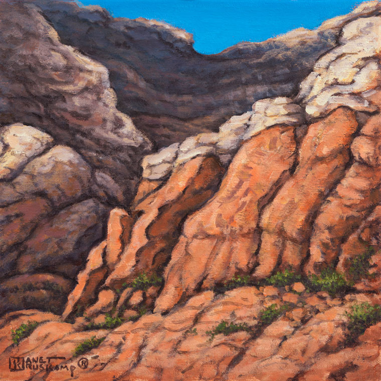 Red Rock Canyon #2, an acrylic landscape painting by renowned artist Janet Kruskamp. Vertical cracks lead up the weathered red sandstone canyon walls, the cracks populated by small plants wherever they can gain a foothold. A lighter colored rock with horizontal layers sits at the top of the steep canyon wall. One of the Interiors and Exteriors Gallery by Janet Kruskamp.