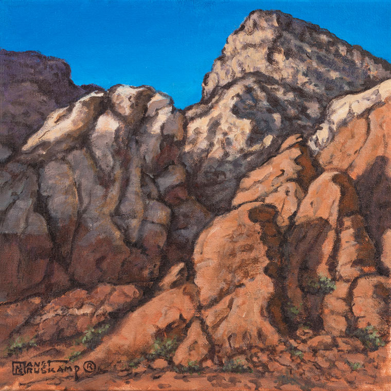 Red Rock Canyon #4, a landscape painting by world famous artist Janet Kruskamp. Red sandstone is topped by a lighter colored layer at the top of the canyon wall, forming into a peak. Small patches of green cling to the cracks in the canyon wall, spreading out t slightly at the canyon floor. An azure blue sky contrasts with the earthy tones of the canyon wall. One of the Interiors and Exteriors Gallery by Janet Kruskamp.