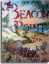 Beacon Point is another lush vintage travel poster from artist Janet Kruskamp. The beautiful seaside scene is anchored by a white lighthouse with a red cap that appears in front of the title of the poster in the upper left, overlooking the crystal blue bay and a sailboat skimming along the water. Two weathered wooden chairs at the base of the poster face forward towards the bay, a glass of lemonade sits on a small table between the chairs. The large type says Beacon Point Inn and Restaurant in weathered red. Palm trees sway in the wind across the bay to the point. Trees blown by the wind complete the poster in the upper right, showing you what a great day to be sailing.