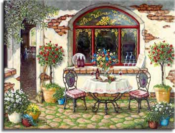 The Wine Cellar, a giclee , personally enhanced and by the artist Janet Kruskamp showing the front window, door and outdoor table of The Wine Cellar. The table is set with wine, bread and fruit. Pots and planters of brightly colored flowers surround the table and doorway. The outside wall around the front window shows the age of the building in the patches of missing plaster.
